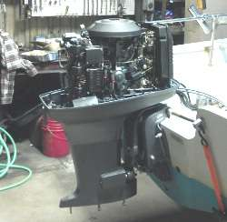 a yamaha outboard engine being repaired in a boat shop