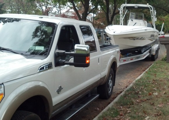 Boat Movers with a triple axle trailer to Florida